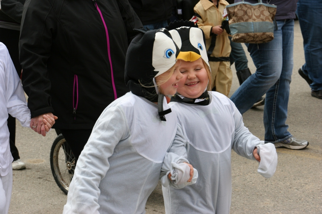 costume-parade-205-penguins-holding-hands