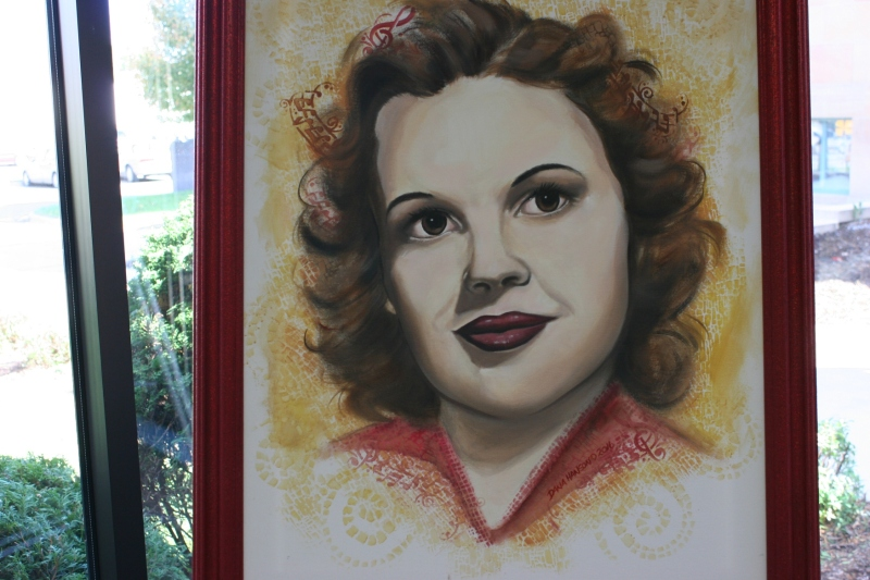 "Dana Hanson also painted this portrait of Judy Garland, who was inducted in to the Minnesota Music Hall of Fame in 1991. Judy was born as Frances Ethel Gumm in Grand Rapids, Minnesota, and starred in ""The Wizard of Oz."""