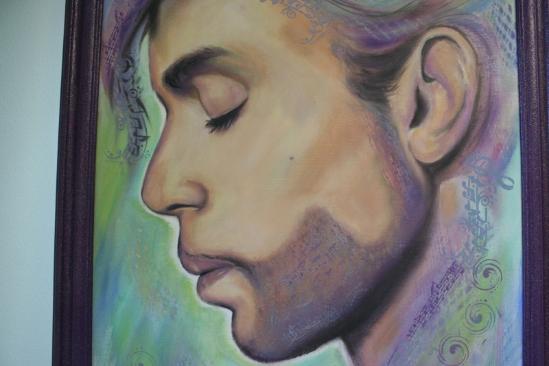 Dana used a stencil to incorporate musical notes in to this painting of Prince. Notice the detail of the heart-shaped mole on the musician's cheek.