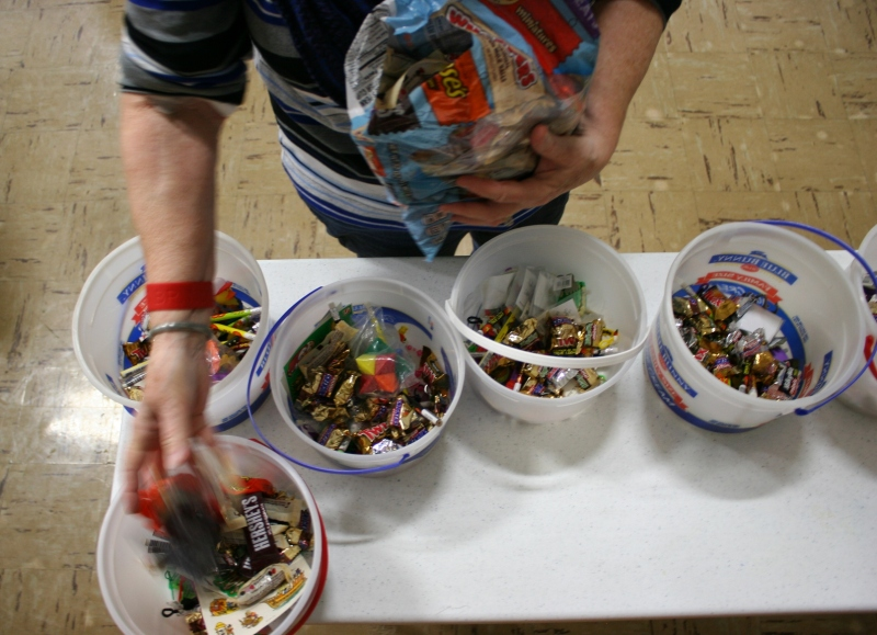 Sorting candy for game prizes. There will also be non-candy prizes.