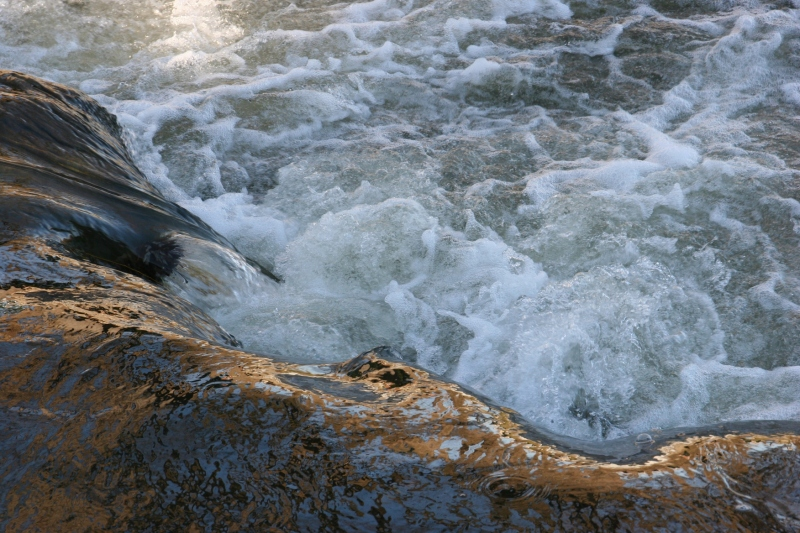 Water churns in the Straight River at the Morehouse Park dam.