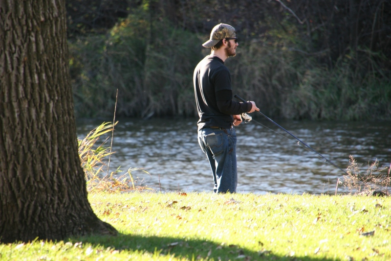 Sunday afternoon fishing along the Straight River in Morehouse Park.