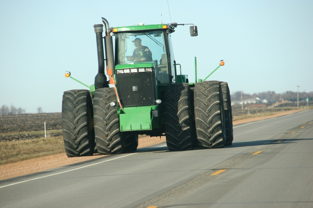 A farmer guides his John Deere tractor along Minnesota State Highway 67 near Morgan.