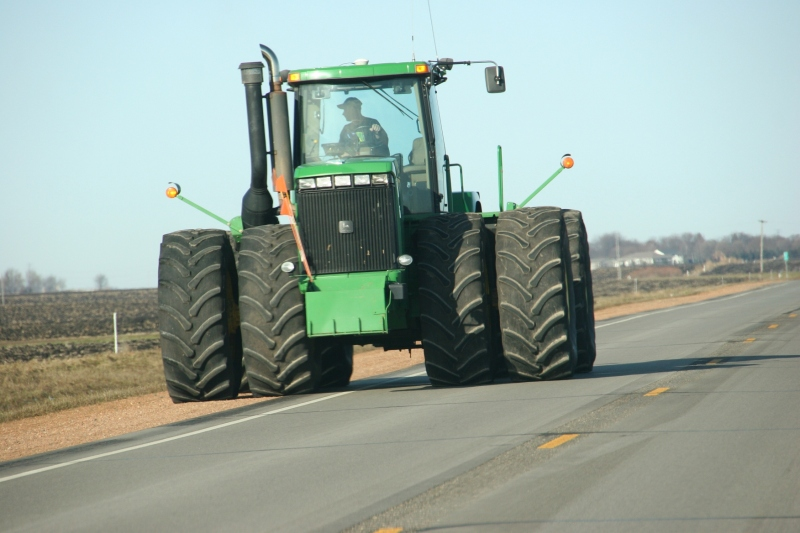 A farmer guides his John Deere tractor along Minnesota State Highway 67 near Morgan.