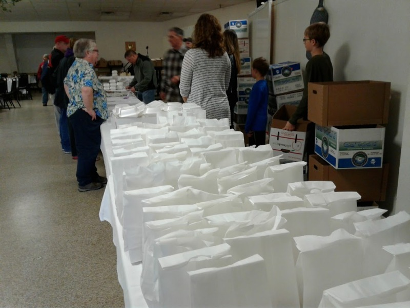 Bagged lunches await pick up by guests and by those delivering meals to homes.