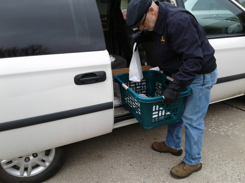 Randy shuffles meals and bags around as we prepare to deliver them.