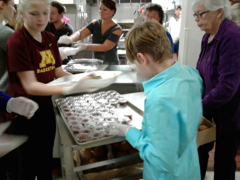 Volunteers dish up meals.