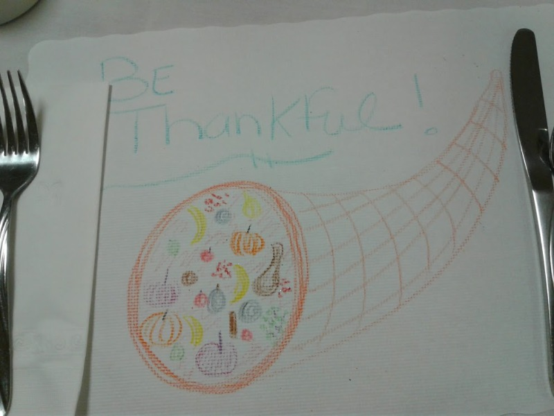 A child's artwork on a placemat reminds diners of life's many blessings.