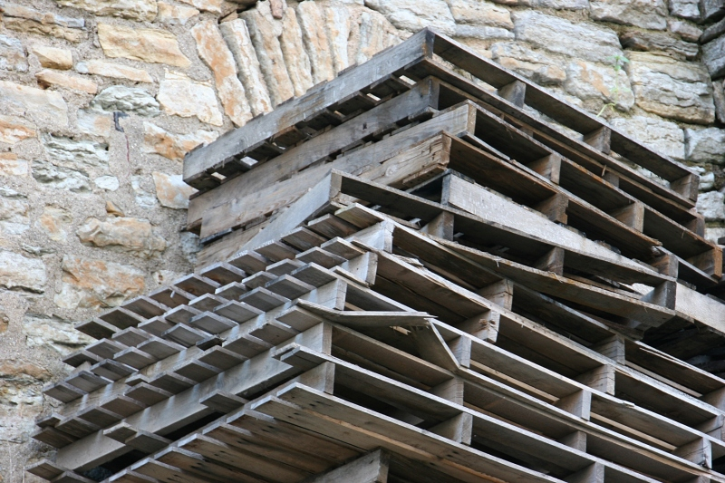 trail-10-pallets-stacked-by-limestone-building