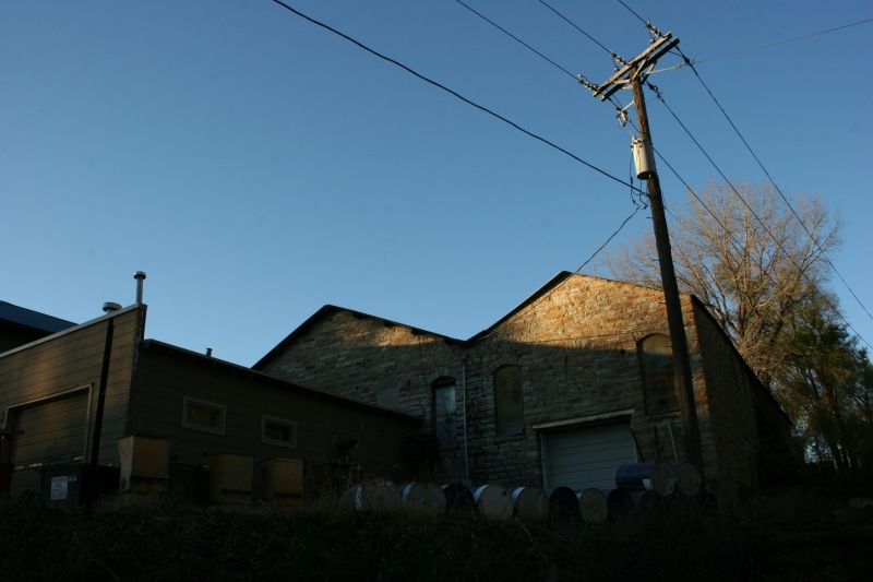 trail-4-side-of-limestone-building-with-barrels
