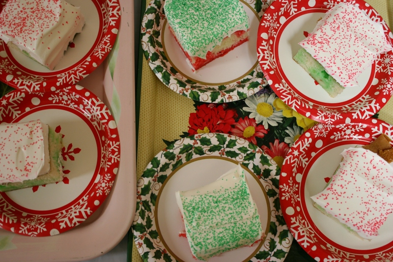 Slices of Christmas cake are plated and then delivered to diners on vintage trays.