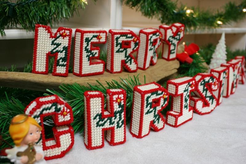 Christmas decorations grace a shelving unit.