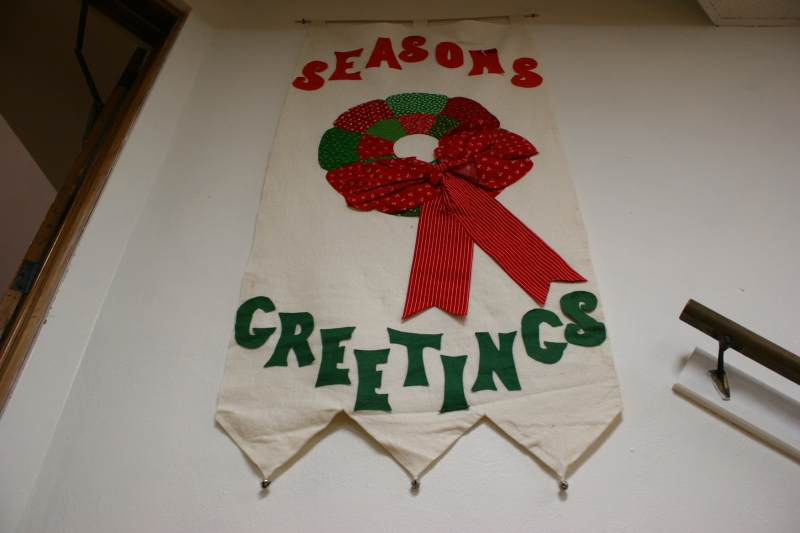 Holiday banners hang from basement walls.