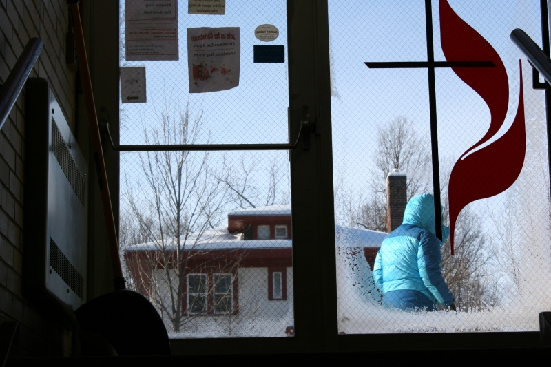 Despite temperatures in the double digits below zero, people braved the cold to attend the Community Christmas Dinner. Here a diner leaves the church.