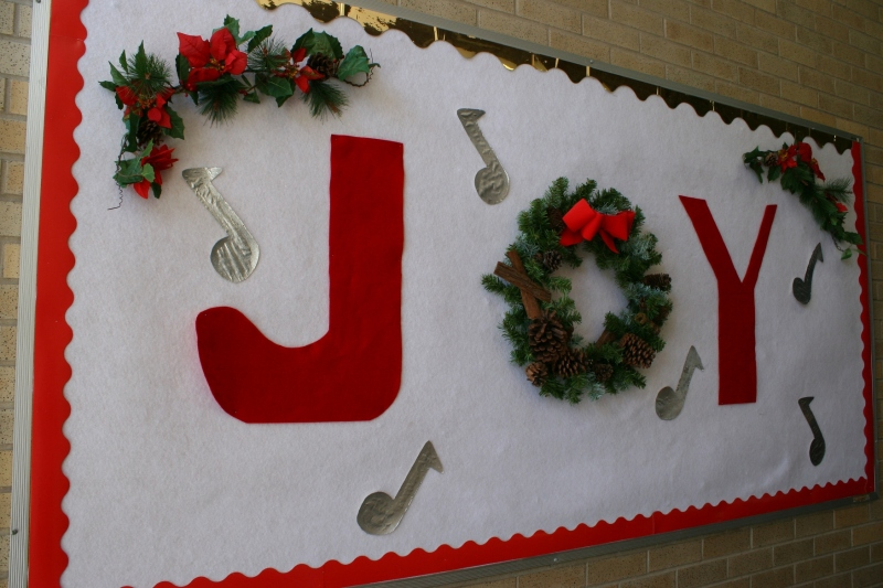 This bulletin board, just inside the side entry to the church basement, proclaims holiday joy.
