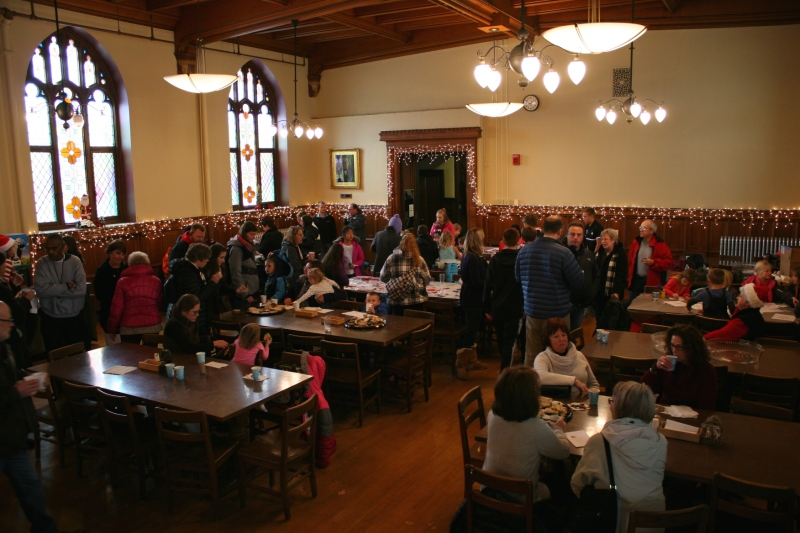 A sizable crowd of kids and adults gathered for holiday treats and kids' activities.