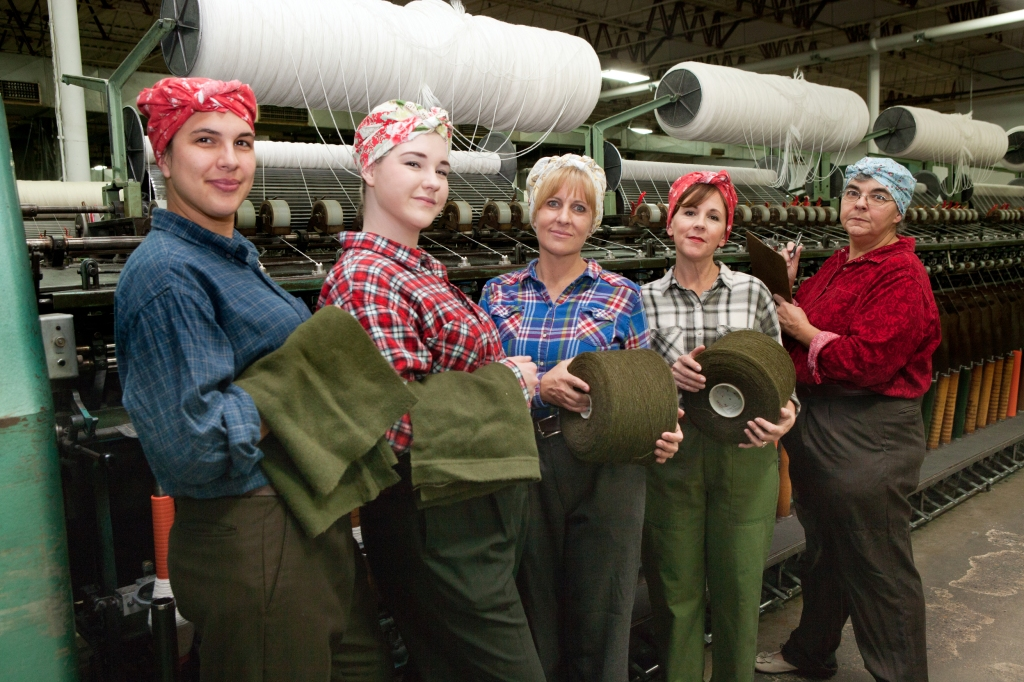 """Some of the cast members of """"Wrapped in Love & Glory"""" pose inside the Faribault Woolen Mill. Photo by Edward Brown."""