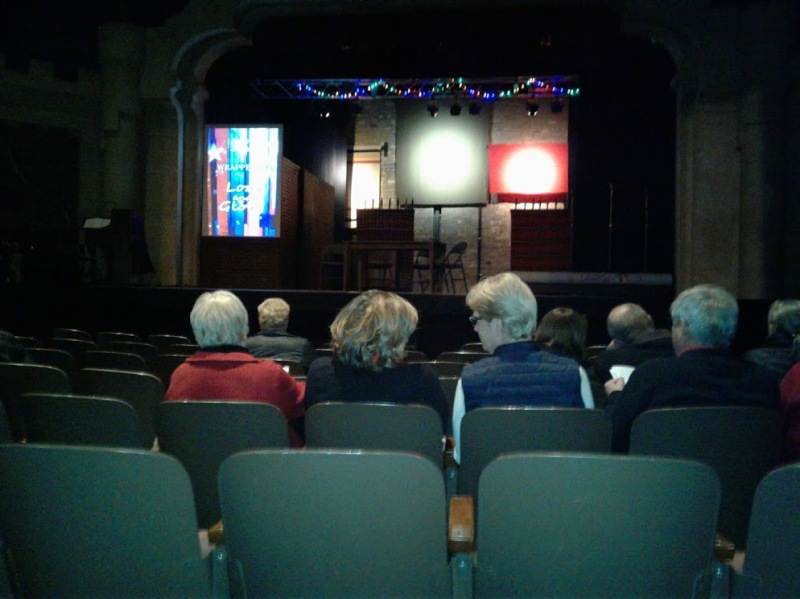 Before the play opened, I took this cell phone image of the set showing Woolen Mill blankets suspended with the video screen to the left.