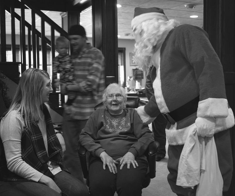Santa visits with my mom and my niece.
