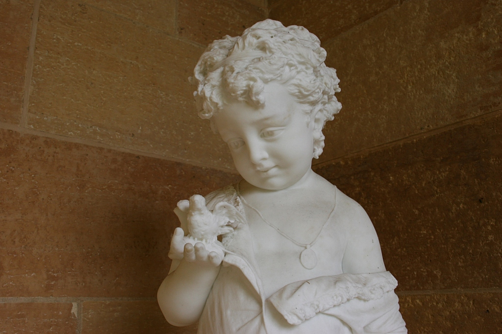 "Italian master sculptor created this marble sculpture titled ""Girl with a Bird."""