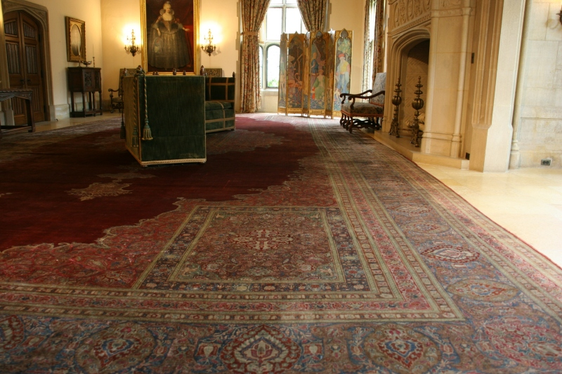 The Great Hall, designed for leisure and entertainment, features an aged rug. Visitors cannot walk on that rug.