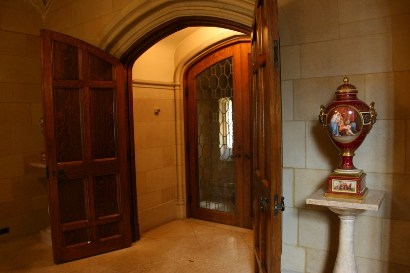 Arched doors and doorways, heavy doors, art and more define The Paine.