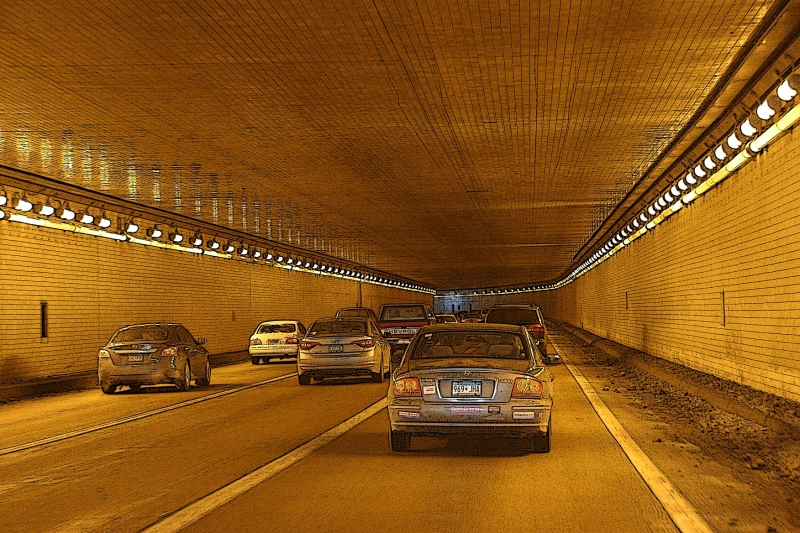 Passing through the Lowry Tunnels always seems visually surreal to me, like driving through a video game.