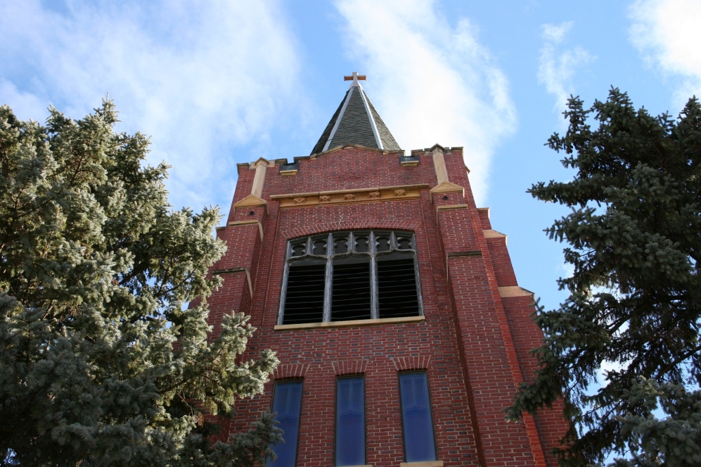 Looking up at the tall tall steeple.