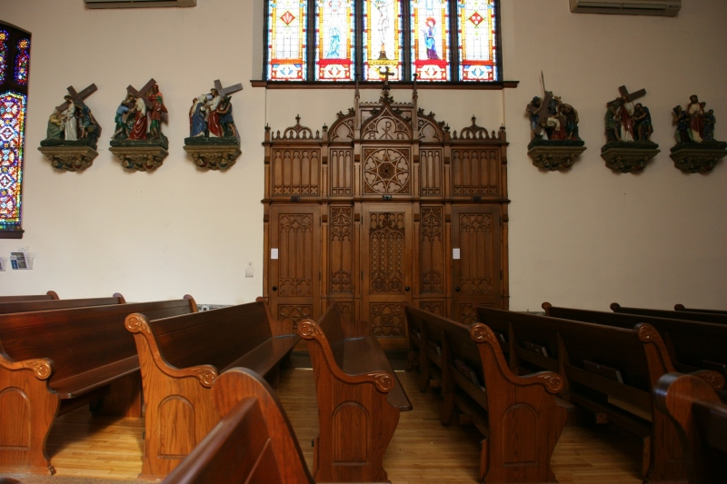 Impressive woodworking on a confessional, one of two.