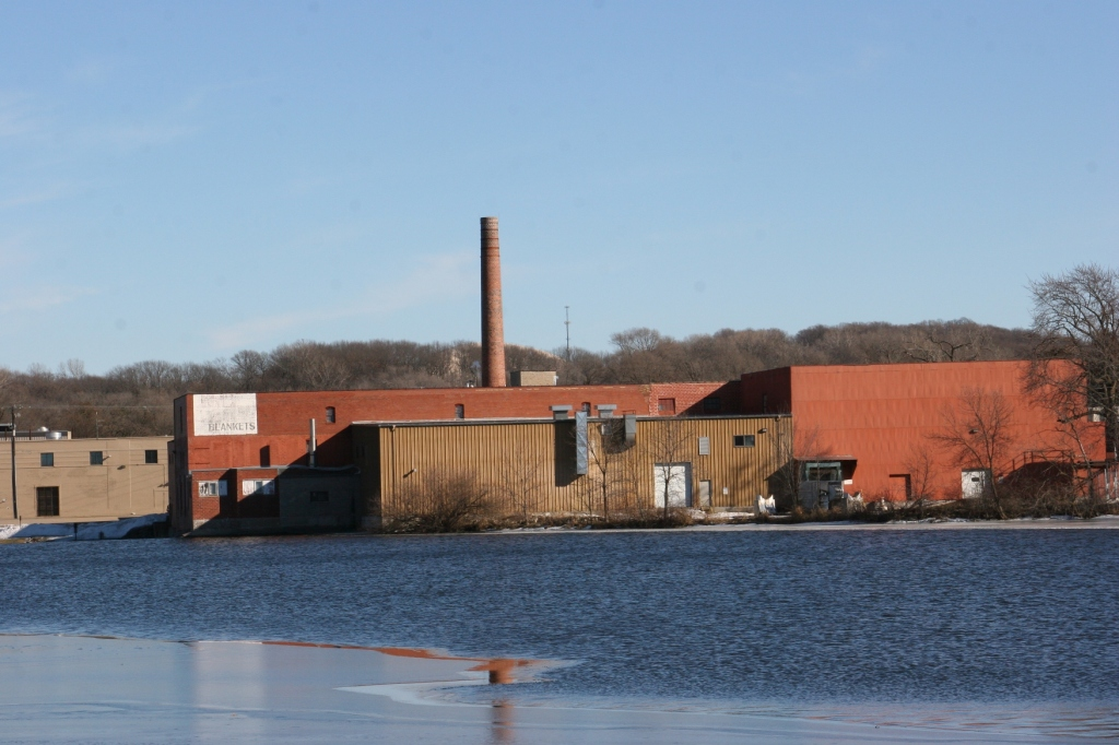 The back of the mill as photographed from the North Link Trail. The mill is on the National Register of Historic Places. Several years ago the city of Faribault received a $300,000 Minnesota Historical Cultural Heritage grant for rehab of the smokestack.