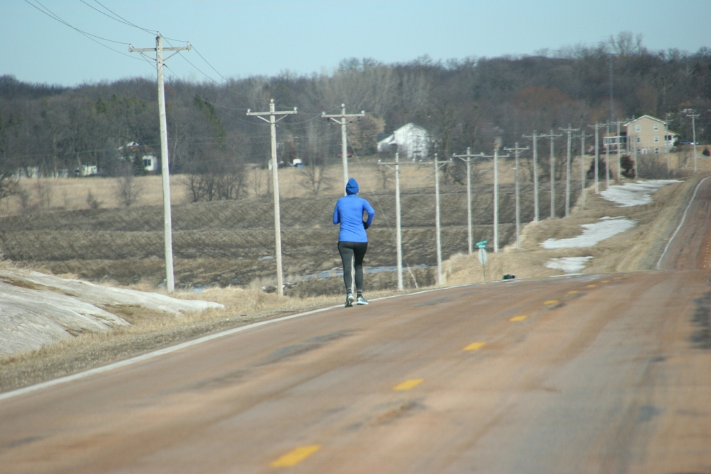 Runners ran along city streets and sidewalks and along rural roads in ideal weather conditions, here along Rice County Road 46.