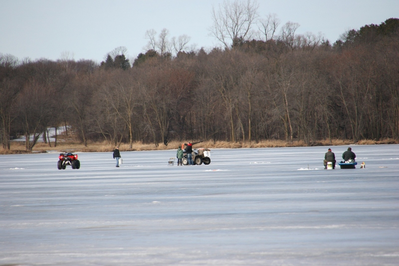 Saturday proved a perfect warm and sunny day for sitting on an overturned bucket on the frozen lake to fish.