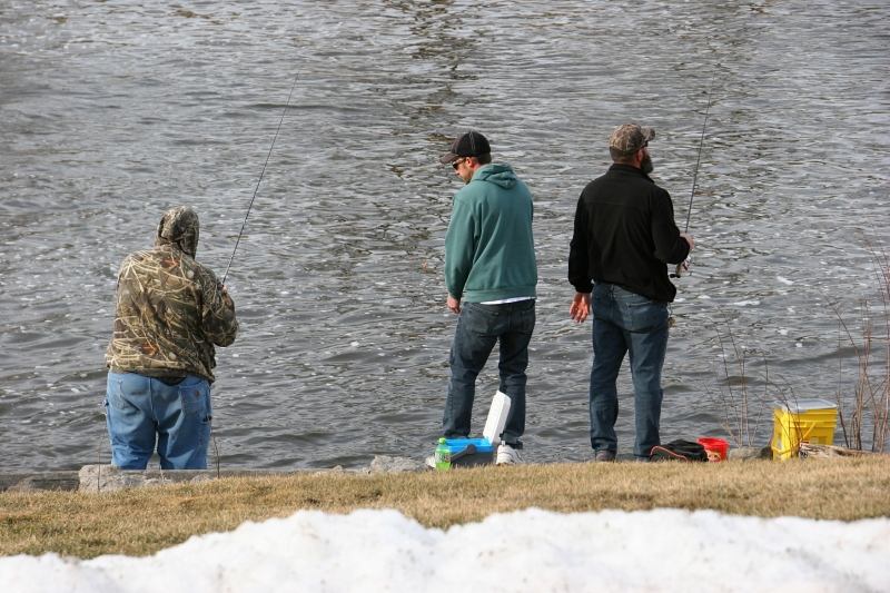 Minnesotans fished, here Sunday afternoon from the banks of the Cannon River by the woolen mill dam in Faribault. Snow pushed from the parking lot edged the river bank.