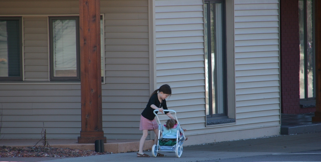 Families were out and about everywhere, including this little girl with her baby doll in downtown Jordan.