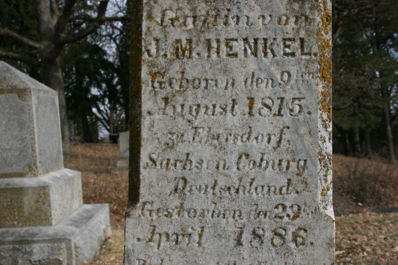 A tombstone inscribed in German.