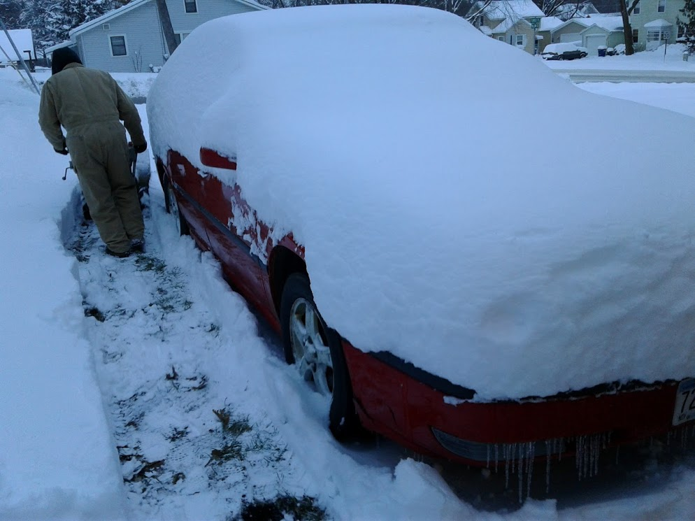 Randy blows a path around the car so I can sweep the snow from it without walking knee-deep in snow.