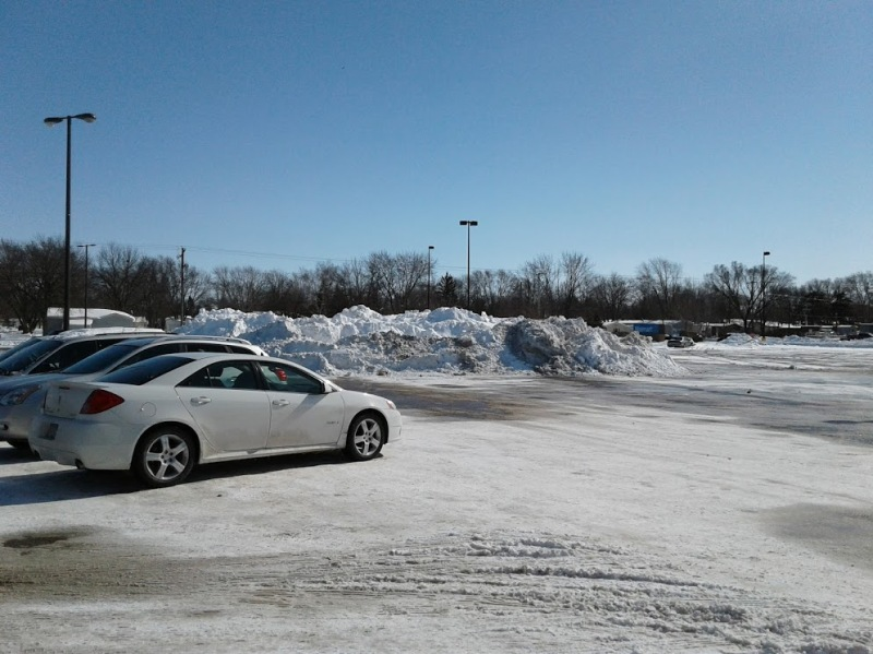 Snow from the Walmart and mall parking lot if pushed into mini mountains.