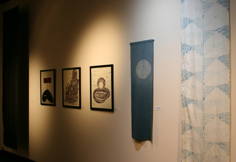 "This series of fiber art pieces by Northfield artist Judy Saye-Willis also honors Barb Larson. The pieces, from left to right, are titled ""Darkness of Death 1"", ""Darkness of Death 2"", ""Destruction"", ""Hope"", ""Hope Rising"" and ""The Light of Hope""."