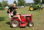 Ag show, #103 boys on lawn tractor
