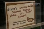 Steve's Meat Market, #94 sign inwindow