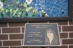 Barb Larson memorial, #7 plaque & art inbackground