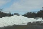 Snowy Faribault, #111 snow piled in hs parkinglot