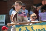 Memorial Day in Faribault, #343 boy carrying Cub Scoutbanner