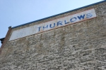 Pequot Lakes, Hardware store Thurlow's sign on brick#192