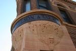 Decorah, #105 stone face on Nelsonbuilding