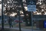 Madison, #5544 guy with bike wheel onback