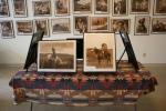 Photo exhibit, #5851 photos on table inforeground