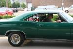 Car cruise, #8337 green car people inclose-up