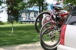 Peony gardens, #7979 bikes with deck inbackground