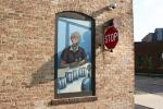 Kipp murals, #1027 woman & stop sign oncorner